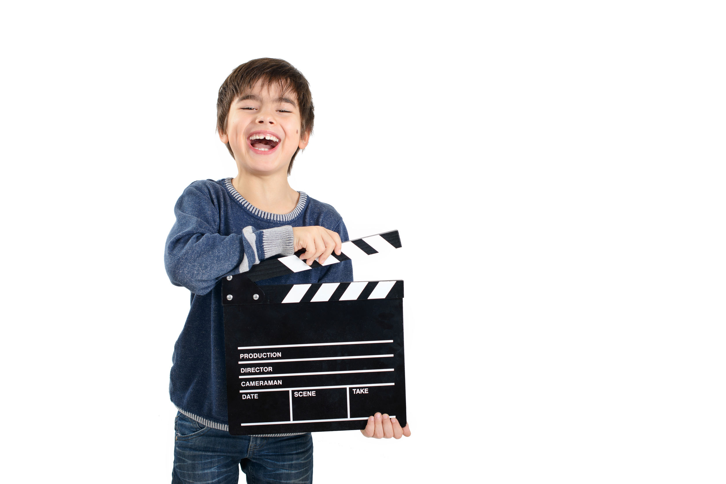 34719651 - laughing child holding clapperboard