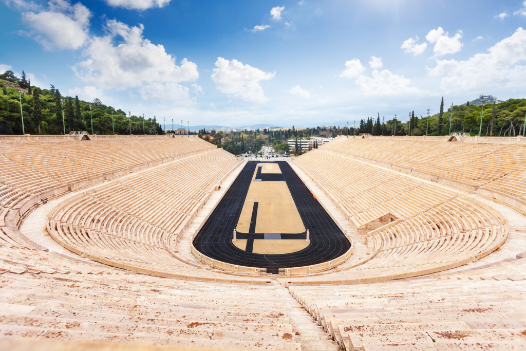 Symmetric view of Panathenaic Stadium in Athens, Greece in summer with stairs and city on background