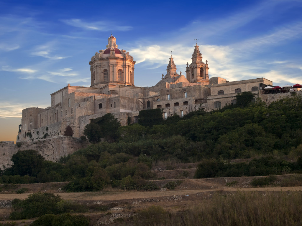 The beautiful city of Mdina gently kissed by the last rays of the sun on a summer's day