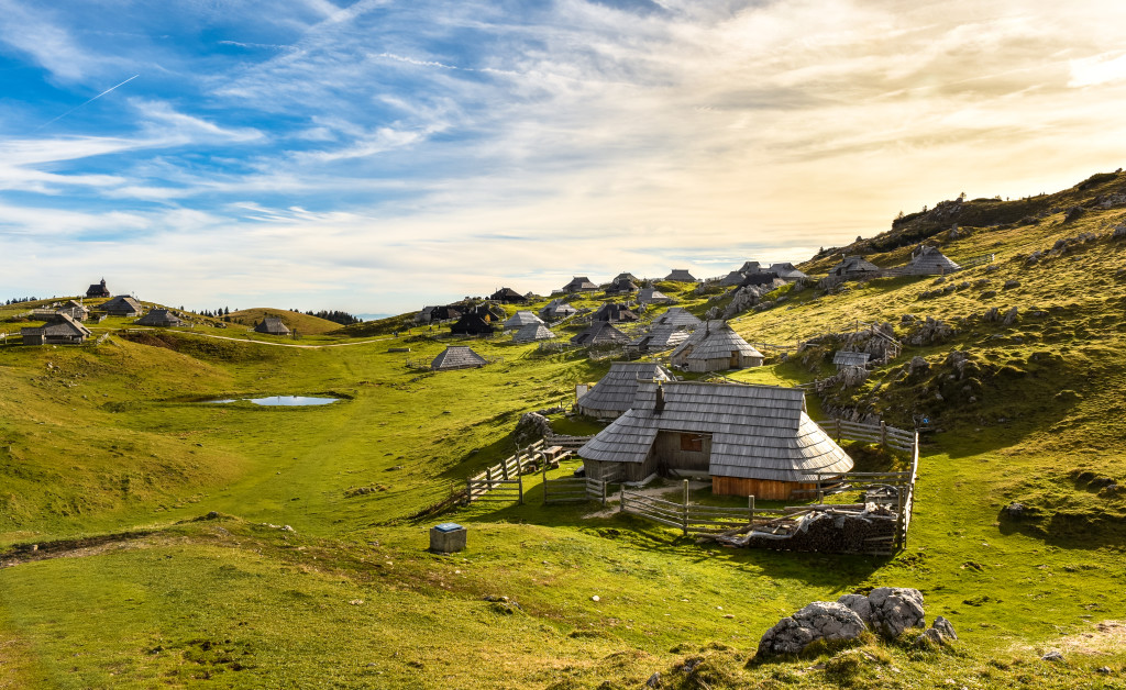 Mountain cottage hut or house on idyllic hill Velika Planina. Bio Eco farming healthy life. Travel destination for family hiking.